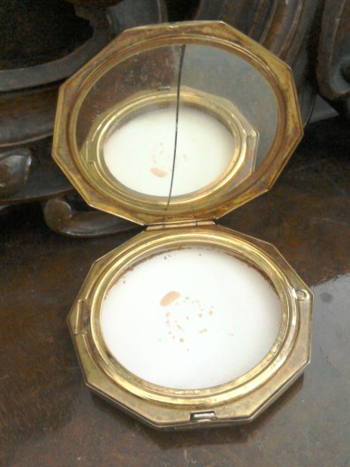Compact with cracked mirror