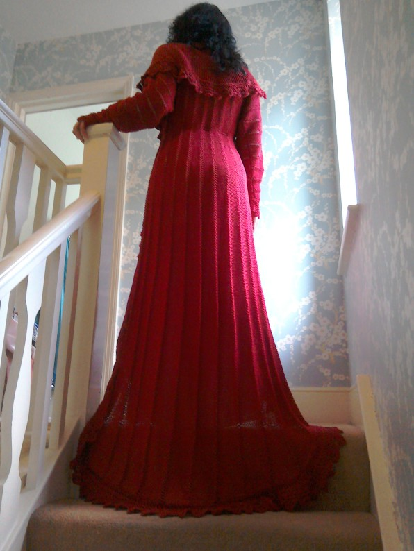 Long red knitted dressing gown train Rowan pattern