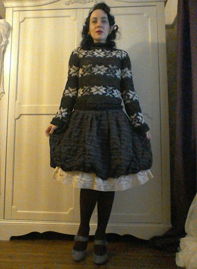 The Killing Sarah Lund's Dark jumper with checked skirt and frills vintage styling