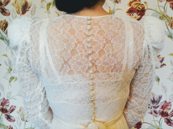 Button and sash detail on back