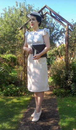 Thirties style summer skirt and frill sleeve blouse worn with black and cream hat