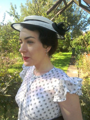 Black and cream hat worn Thirties style - side