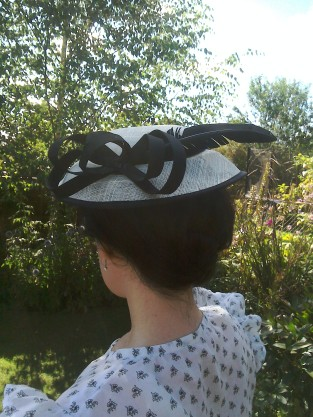 Black and cream hat with feather worn Thirties style