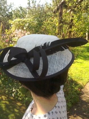 Black and cream hat with feather worn Thirties style - back