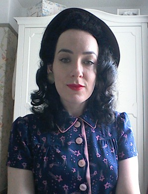 Brown Forties hat with front curls