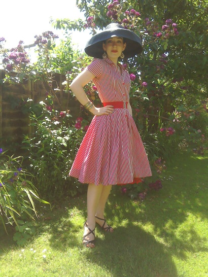 Black wide brimmed hat and gingham dress