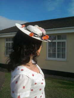 Cream lace tilt hat with flowers and black net