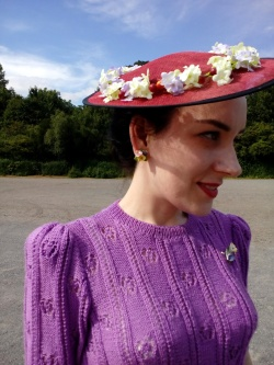Modern red tilt hat dressed with flowers