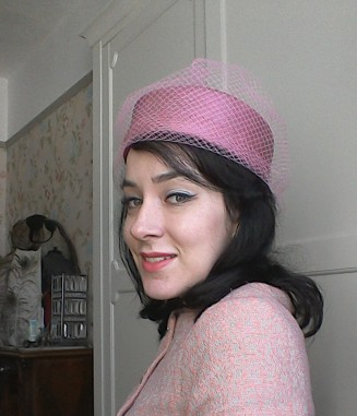 Pink pill box hat with net - front