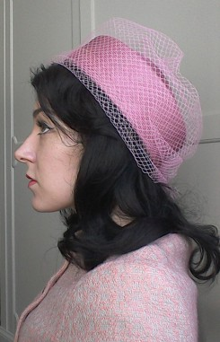 Pink pill box hat with net - side