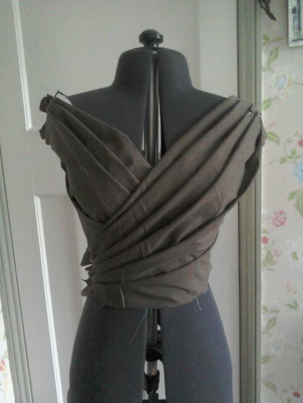 Wrapover front folds of bodice